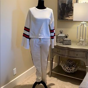 Cream sweatsuit with blue and red strips